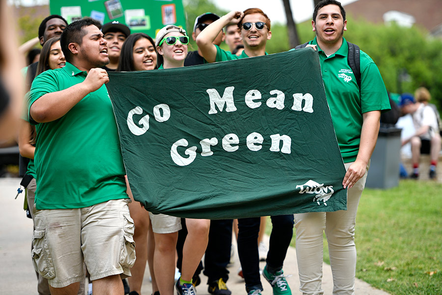 Marchers with Go Mean Green sign at University Day