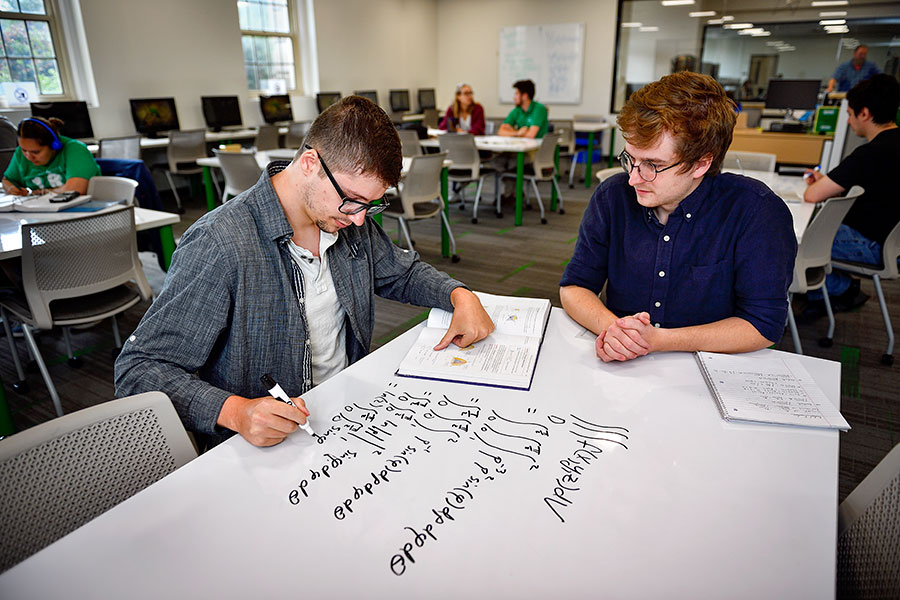 Two students working together on a project