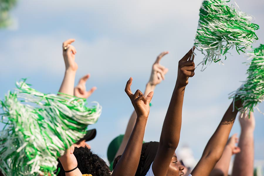 UNT fans waiving pom-pons