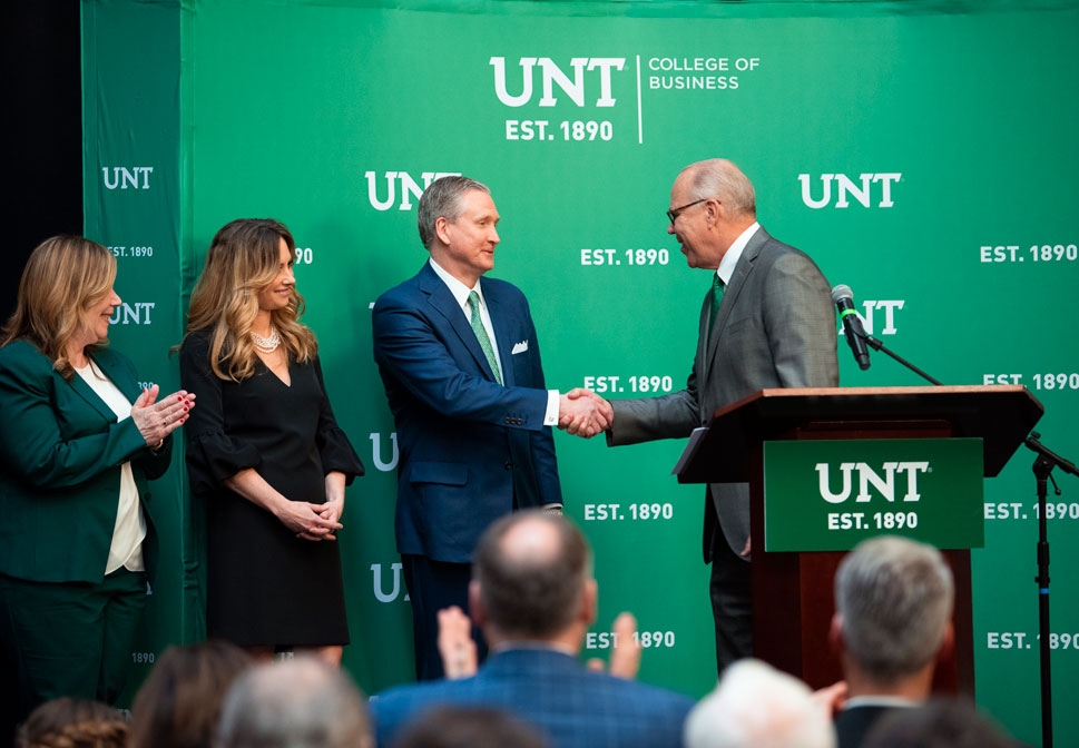 G. Brint Ryan shakes the hand of UNT President Neal Smatresk