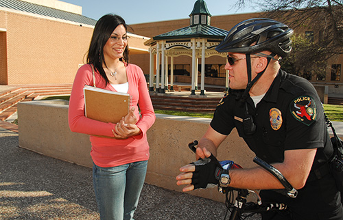 UNT student chatting with a UNT Policeman